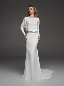 Sleek fitting wedding dress with train